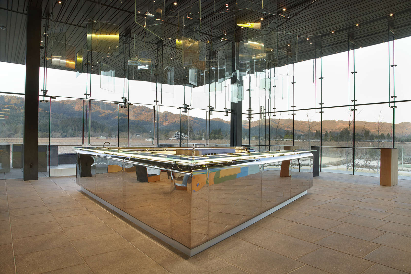 Hall Winery approached NICOLEHOLLIS for the interior design of its new St. Helena winery complex. A highlight is the custom 23-foot mirror-polish bar.