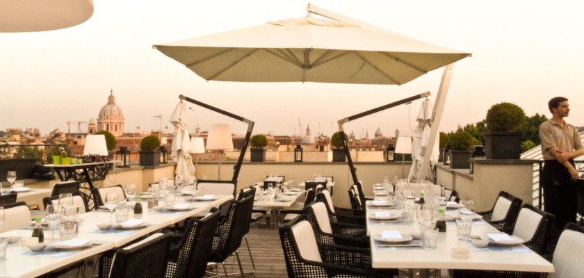 Setting the table.  The restaurant on top of THE FIRST Luxury Art Hotel Roma will be jam-packed within the next hour.
