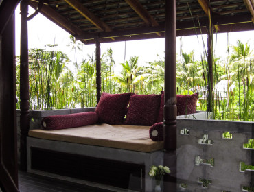 A place to lounge. The Deluxe Balcony at the Muang Kulaypan