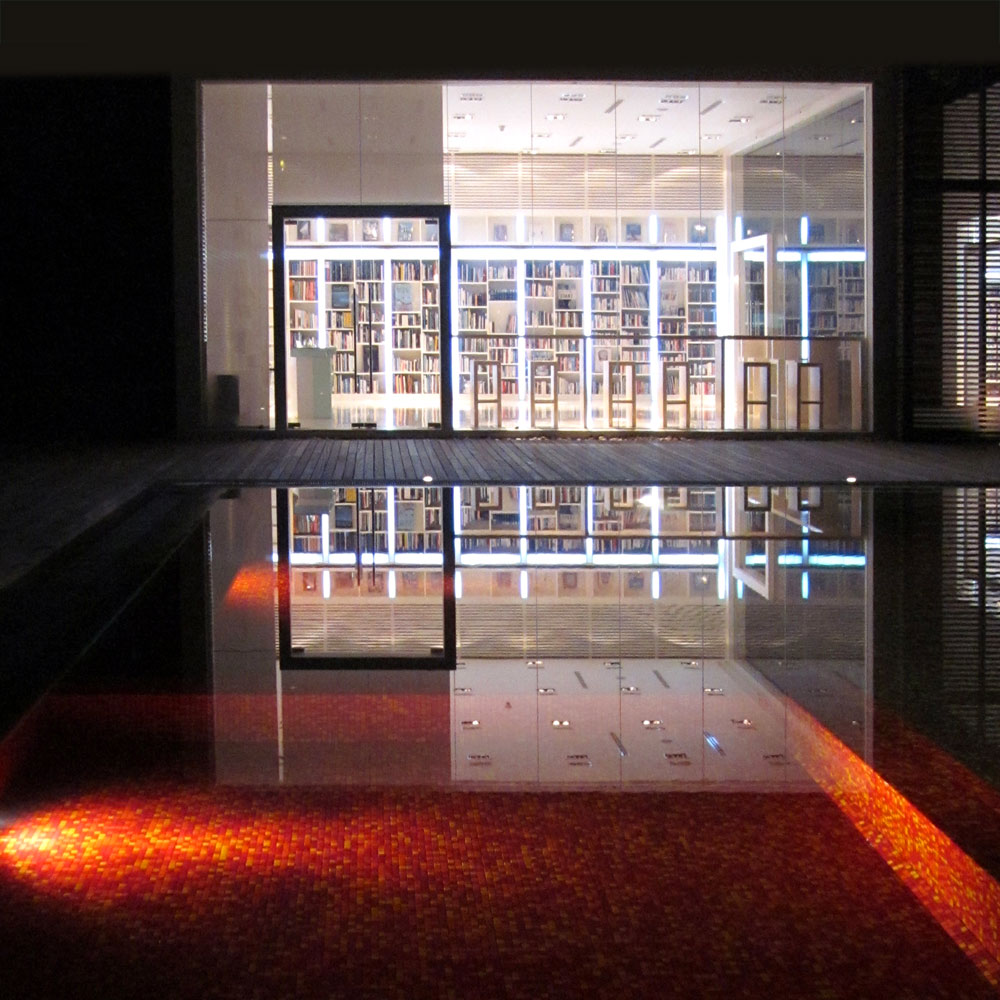 The Library, Koh Samui. The iconic red pool at night. Photo: the art resort