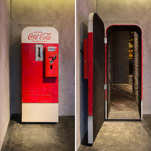 Unsuspecting customers at Shanghai's The Press are surprised when they realize that the Coke vending machine a is the door to a beautifully designed bar.