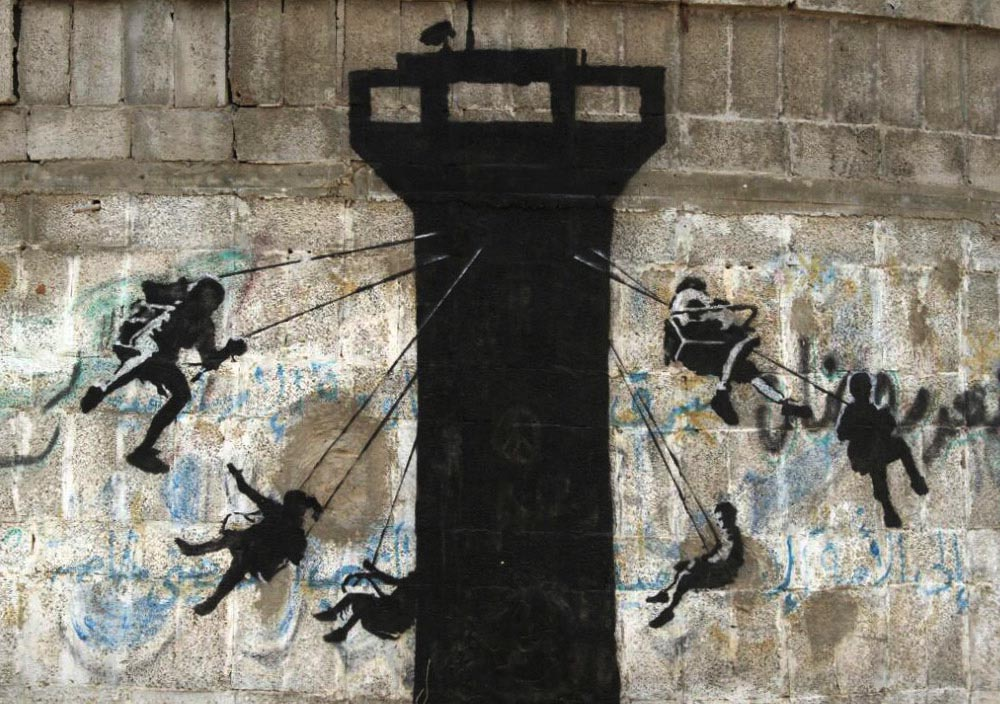 A mural of a watch tower turned chairoplane by Banksy, Gaza City.