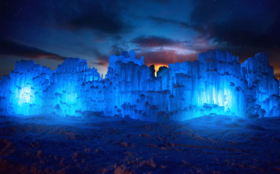 The Lincoln Ice Castle New Hampshire. The glacial wonderland is illuminated by night. Photo Ken Skuse.